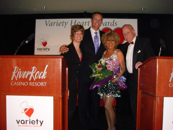 Luisa Marshall presented with a bouquet of flowers from Tammy Corness, Chris Gailus of Global TV and Bob Stewart, President of the Variety Club after doing her Tina Turner Impersonation in benefit for the Variety Volunteers at the River Rock Casino in Richmond.