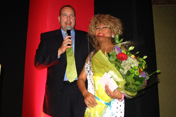 Luisa Marshall receiving flowers from Global TV News Anchor, Steve Darling, after performing for the Big Sisters Divas Gala Fundraiser.