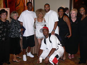 Tina Turner Tribute Artist Luisa Marshall with members of the Seattle Seahawks NFL team alongside organizers and fans after her performance at the NBA Hall of Famer Lenny Wilkens Celebrity Classic in Seattle.