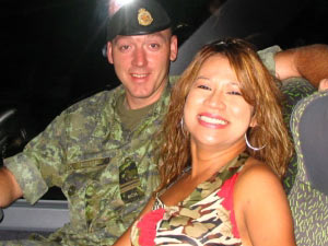 Tina Turner Tribute Artist, Luisa Marshall, with her bodyguard in Bosnia.